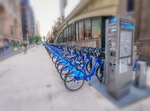 NEW YORK, USA - JUNE 8, 2013: Tourists near bike rental station. New York attracts 50 million people every year Royalty Free Stock Photo