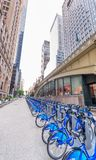 NEW YORK, USA - JUNE 8, 2013: Tourists near bike rental station. New York attracts 50 million people every year Stock Images