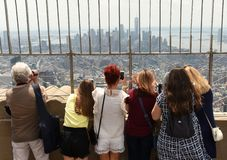 New York, USA - June 8, 2018: Tourists on the observation deck o. F Empire State Building in NYC stock image