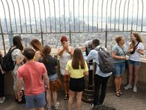 New York, USA - June 8, 2018: Tourists on the observation deck o. F Empire State Building in NYC royalty free stock photos