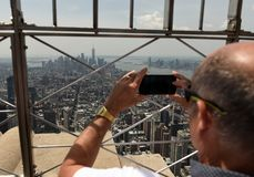 New York, USA - June 8, 2018: Tourists on the observation deck o. F Empire State Building in NYC stock images