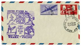New York, The USA  - 19 June 1947: US historical envelope: cover with sport cachet Unites States Air Mail first flight Helsinki Fi. Nland, two postage stamps royalty free stock photography