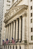 New York, USA - June 18, 2016: Vertical view of the New York Stock Exchange with American flags Stock Photography