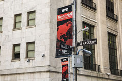 New York, USA - June 18, 2016: Wall street and Nassau street sign post crossing with NYC banner sponsored by BGC partners Stock Photography