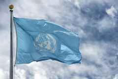 NEW YORK - USA - 11 JUNE 2015 Waving united nations UN flag. In the deep blue sky background Stock Photos