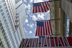 New york usa manhattan sign with american flag stock photography