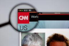 CNN channel logo visible  through a magnifying glass. royalty free stock photos