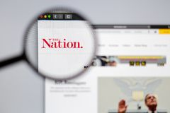 The Nation logo visible  through a magnifying glass. stock image