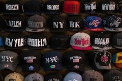 Baseball caps in store in New York royalty free stock image