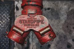 Close up top view of a red fire hydrant on a street in New York, USA. royalty free stock photo