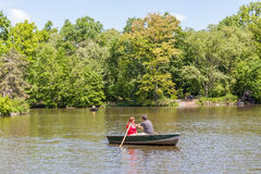 New York, USA- May 20, 2014. A couple rowing the rowboat in lake Royalty Free Stock Images