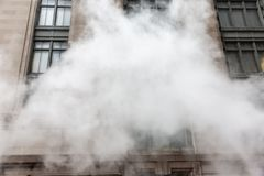 Vapor from street underground in NYC royalty free stock photo