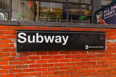 New York City subway sign entrance on brick wall. New York, USA - May 6, 2018 : New York City subway sign entrance on brick wall royalty free stock photos