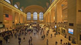 Panning shot of commuters at Grand Central Station in New York stock video