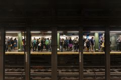 Passengers waiting for train in a subway station in New York City Stock Images