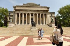 New York, USA - May 25, 2018: People near the Alma Mater statue. Outside of Columbia University library royalty free stock photos