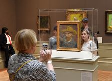 New York, USA - May 26, 2018: People near the Vincent van Gogh. Self-Portrait with a Straw Hat in the Metropolitan Museum of Art in New York City royalty free stock image