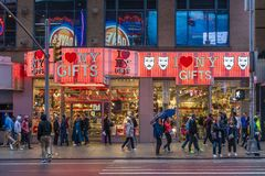 People outisde a gift shop near Times Square in New York City royalty free stock images