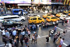New York, USA - May 24, 2018: People and yellow taxis at Times S stock images