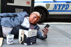 New York, USA - May 30, 2018: Street beggar wears a Trump mask a stock images