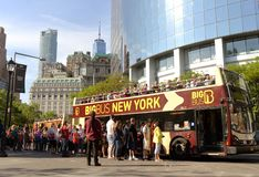 New York, USA - May 30, 2018: Tourists near Big Bus New York Hop. On Hop-Off Bus Tour in New York royalty free stock photo