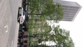 NEW YORK, USA - MAY 5, 2019: Vertical video. City street stock footage