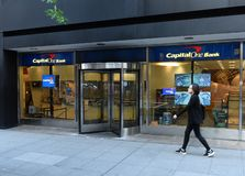 New York, USA - May 30, 2018: Woman pass near Capital One Bank i. N New York royalty free stock photography
