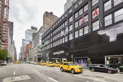 Yellow cabs parked in front of the Bloomingdale`s department store. stock image
