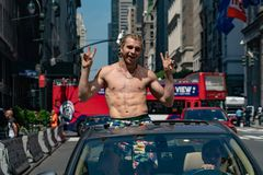 NEW YORK, USA - MAY 25 2018 - Young man in a car in Times square full of people Stock Images