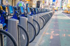 NEW YORK, USA - NOVEMBER 22, 2016: Close up of bike rental on Times Square parked in a row in the street in New York Royalty Free Stock Photos