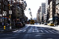 New York, USA - NOVEMBER 2018: Manhattan street with smoke and schoolbus royalty free stock photography