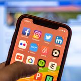 Social media app icons on modern new smartphone Stock Image