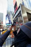 Cellular Photography Tourist Times Square Manhattan New-York Win Royalty Free Stock Photos