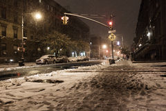 Snow at Manhattan Avenue New-York. New-York, USA - November 7th, 2012: The intersection of Manhattan Avenue and 122nd street in Harlem covered with snow with Stock Images