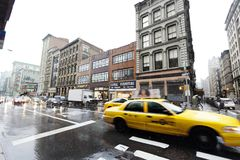 Yellow Taxi Traffic in Rainy Broadway Manhattan New-York Royalty Free Stock Images