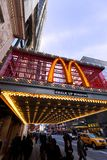 McDonald's at 42nd Street New-York. New-York, USA - November 6th, 2012: Wide angle view of big M sign at the entrance of the McDonald's branch located at 220 W Stock Photo