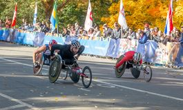 Wheelchair division participants during Annual New York City Marathon royalty free stock image