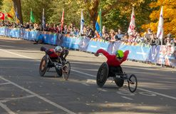 Wheelchair division participants during Annual New York City Marathon royalty free stock photo