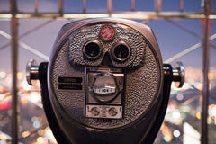 Binoculars on top of Empire State Building at Night in Manhattan stock image