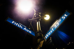 Light Post and Fifth Avenue Street Sign on the corner of the Wes. NEW YORK, USA - October 18, 2016. Light Post and Fifth Avenue Street Sign on the corner of the Royalty Free Stock Image