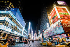 Timesquare at Night with Bright Adds and Yellow Cabs. NEW YORK, USA - October 17, 2016. Timesquare at Night with Bright Adds and Yellow Cabs royalty free stock photography
