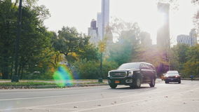 New York, USA - OKT, 2016: The famous yellow cabs and other vehicles traveling on the road near Central Park. Against. The famous yellow cabs and other vehicles stock video