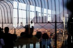 Observation deck of the Empire State Building. NEW YORK, USA - Sep 17, 2017: Abstract image of lights, shadows and reflections on the observation deck of the royalty free stock photography