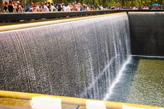 New York, USA - September 2, 2018: Abstract view of the fountains at the 9 11 memorial. Manhattan, New York, USA royalty free stock image