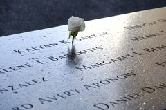Names and a rose at the 9/11 Memorials. NEW YORK, USA - September 29, 2017: Names of the victims and a white rose at the National September 11 Memorial, in New Royalty Free Stock Photography