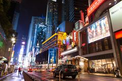 Night street Broadway in New York . Yellow taxi, many people and advertising outdoor royalty free stock images