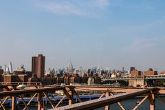 New York, USA - September 2, 2018: The skyline of Lower Manhattan as seen from the Brooklyn Bridge. The Brooklyn Bridge stock image