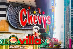 Chevy`s restaurant sign near Times Square. New York, USA - 28th September, 2016: Close up of the Chevy`s restaurant sign near Times Square, a lively, informal Stock Photos