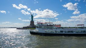 Free New York, USA. White Cruiser Boat In Front Of The Statue Of Liberty. Summer Time. Tourist Attraction Stock Photo - 157963360