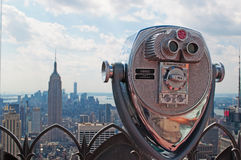 New York: view of Manhattan skyline, Empire State Building and Top of the Rock binocular on September 16, 2014 Stock Photos